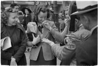 Nile Shrine members collecting relief from passersby, Los Angeles, 1938