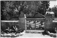 Gate marking the entrance to 4-year-old Gloria Lloyd's private mini-estate on her parent's sixteen-acre estate, Beverly Hills, 1927