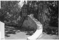 Slide on 4-year-old Gloria Lloyd's private mini-estate on her parent's sixteen-acre estate, Beverly Hills, 1927