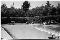Swimming pool and diving board on the estate of film comedian Harold Lloyd and his wife Mildred, Beverly Hills, 1927