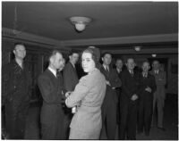 Ruth Jackson, director at The Kern Ridge Oil Company, with a group of unidentified men, Los Angeles, 1941