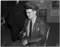 Police officer A.H. Miller turns in his gun and badge, Los Angeles, 1940
