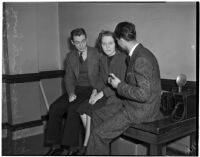 Robert Lange, his sister Ruth Lange and Werner Kawert sitting on a table in the press room, Los Angeles, 1940