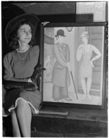"Roma Nicolais poses next to a painting by Dr. A. A. LaVinger titled, ""The Bargain,"" Los Angeles"