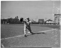 Wayne Murdock, USC Trojans first baseman, poses on the base, Los Angeles, 1940