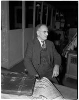 Physical oceanographer Dr. George McEwan of Scripps Institute of Oceanography sits at desk, Los Angeles, 1930