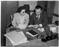 Madam Lee Francis and Judge Cecil D. Holland reading an anonymous letter that was sent to the Judge, Los Angeles, 1940