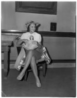Mrs. Inez I. Allen seated in a chair holding a handbag, Los Angeles
