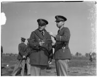 Colonel Holden and Captain Smith stand together during a military show for National Defense Week, Los Angeles, 1940