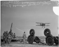 Observation squadron aims anti-aircraft gun at a Douglas plane during a military show for National Defense Week, Los Angeles, 1940