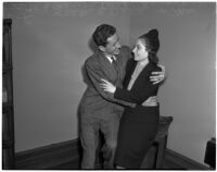 Walter C. Delp in an embrace with his bride-to-be Marion McGuire as they announce their intention to marry, Los Angeles, 1939