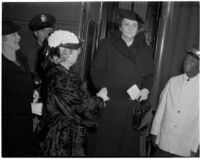 Antoinette Jones welcomes Secretary of Labor Frances Perkins upon her arrival by train, Los Angeles, 1940