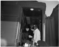 Secretary of Labor Frances Perkins arrives by train, Los Angeles, 1940