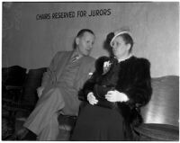 Ruth Reis and Stanley G. Reis wait to provide testimony during the murder trial for Dr. George K. Dazey who was accused of murdering his wife, Los Angeles, 1940
