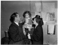 Joe Ryan and Mary Ellen Cope hold 22-month-old Leilani Cope, Los Angeles