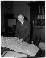 Dixwell L. Pierce sorts folders in a courtroom, Los Angeles, 1940