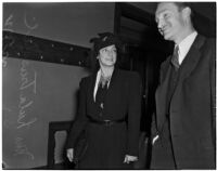 Lula Truschel, wife of Culver City Chief of Police C.T. Truschel, walks out of the courtroom after winning a divorce suit against her husband, Los Angeles, 1940