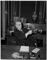 Republican politician Arthur M. Hyde sitting at a desk, Los Angeles, 1940