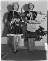 Clubwomen Mrs. Charles R. Smith and Mrs. Leon Kassob dressed up for Valentine's Day, Los Angeles, 1940s