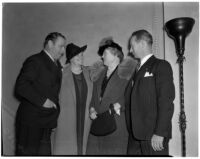 Actor Edmund Burns and his wife in conversation with Dutch hotelier Axel Springborg and his wife, Los Angeles