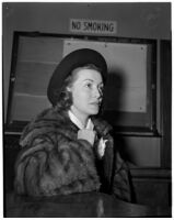 Actress Rosalind Keith in court waiting to have a divorce granted from Willison Clarence Mellor, Los Angeles, 1940