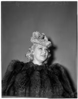 "Mae West in court during questioning about earnings from her role in the movie ""She Done Him Wrong,"" Los Angeles, 1940"