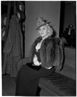 """Mae West sitting in court during questioning about earnings from her role in the movie """"She Done Him Wrong,"""" Los Angeles, 1940"""