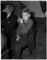 Bradley Bunker, brother of murder victim 11-year-old Marilyn Bunker, sits in court waiting to provide witness testimony, Los Angeles, 1940