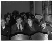 Family members of murder victim Marilyn Bunker sit in court during the trial of the accused murderer Donald Rogers, Los Angeles, 1940