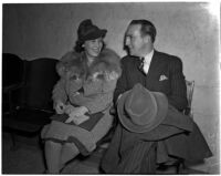 Mary Baker and Raymond Brookes sitting next to each other, Los Angeles, 1930s