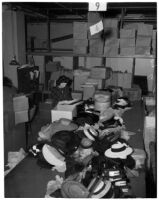 May Co. employee packs hats in preparation for downtown Dollar Day, Los Angeles, 1940