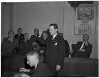 J.W. Buzzell taking oath in court during his trial for reckless driving, Los Angeles, 1940