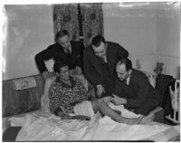 Dr. W.L. Carver with boxer Ceferino Garcia, his manager George Parnassus, and Everett Saunders from the State Athletic Commission, Los Angeles, 1940