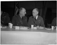 Lieut. Gen. John L. DeWitt and Col. Rush B. Lindon eating dinner at a military banquet at the National Guard Armory, Los Angeles, 1940