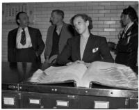 Betty Flay Hardaker stands at a counter in the Los Angeles County Jail after being taken into custody, Los Angeles, 1940