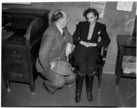 Montebello Chief of Police Maxwell questions Betty Hardaker, charged with the murder of her daughter, Los Angeles, 1940