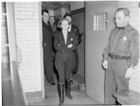 Betty Hardaker, mother convicted of murdering her daughter, walks into the county jail, Los Angeles, 1940