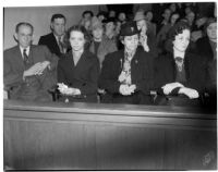 Samuel Karnes, Sr., Johanna Karnes, Edith Karnes, and Audrey Burns sit in the courtroom during the preliminary trial for Betty Flay Hardaker, Los Angeles, 1940