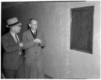 Oma Caneer walks with Samuel Karnes, Sr. after the funeral for his granddaughter Geraldine Hardaker, Los Angeles, 1940