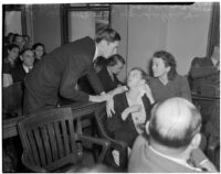 Charles Hardaker comforts his wife Betty Hardaker during her trial for the murder of their daughter, Los Angeles, 1940