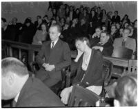 Betty Hardaker, mother convicted of murdering her daughter, sits with her brother Samuel Karnes, Jr. in a courtroom, Los Angeles, 1940