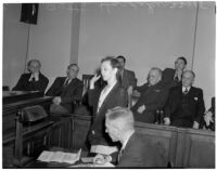 Betty Flay Hardaker takes an oath while on trial for murdering her daughter, Los Angeles, 1940