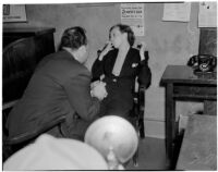 Betty Hardaker, mother convicted of murdering her daughter, during questioning by Dr. Paul De River, Los Angeles, 1940