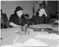 Deputy Sheriff Mary Talbot sits with Betty Flay Hardaker who was convicted of murdering her daughter, Los Angeles, 1940