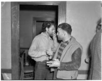"Cowboy film extras Jerome ""Blackjack"" Ward and Yukon Jake re-enacting Blackjack's confrontation with fellow extra Johnny Tyke in Gower Gulch, Los Angeles, February 24, 1940"