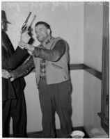 "Cowboy film extra Yukon Jake demonstrates his involvement in the confrontation between fellow extras Jerome ""Blackjack"" Ward and Johnny Tyke, Los Angeles, February 24, 1940"