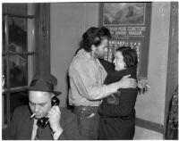 "Cowboy film extra Jerome ""Blackjack"" Ward with his wife Mickey during a re-enactment of his confrontation with fellow extra Johnny Tyke, Los Angeles, February 24, 1940"