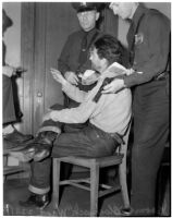 """Cowboy film extra Jerome """"Blackjack"""" Ward talks to police during a re-enactment of his confrontation with fellow extra Johnny Tyke, Los Angeles, February 24, 1940"""