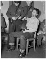 "Cowboy film extra Jerome ""Blackjack"" Ward talks to police during a re-enactment of his confrontation with fellow extra Johnny Tyke, Los Angeles, February 24, 1940"