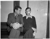 Accused murderer John Frank Reavis with Deputy Sheriff Pat Kelley at Reavis's trial, Los Angeles, May 1940